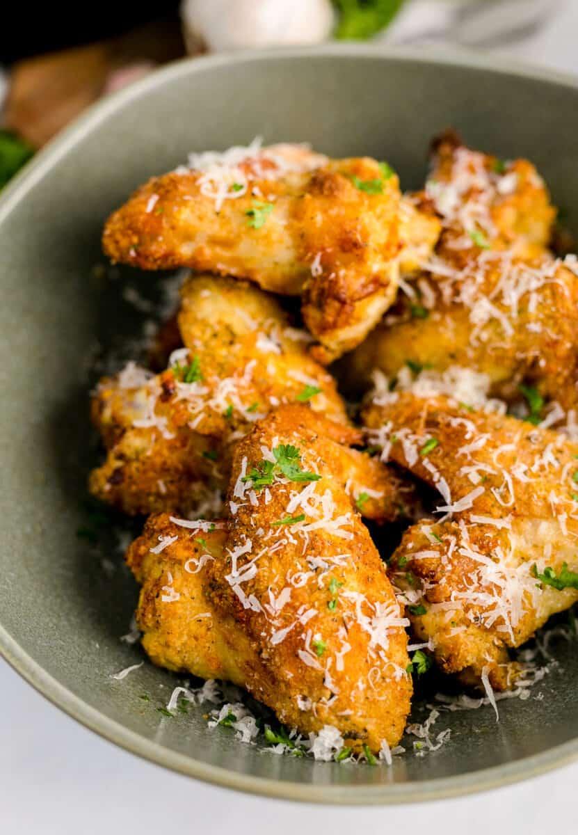 bowl of garlic parmesan wings in an air fryer