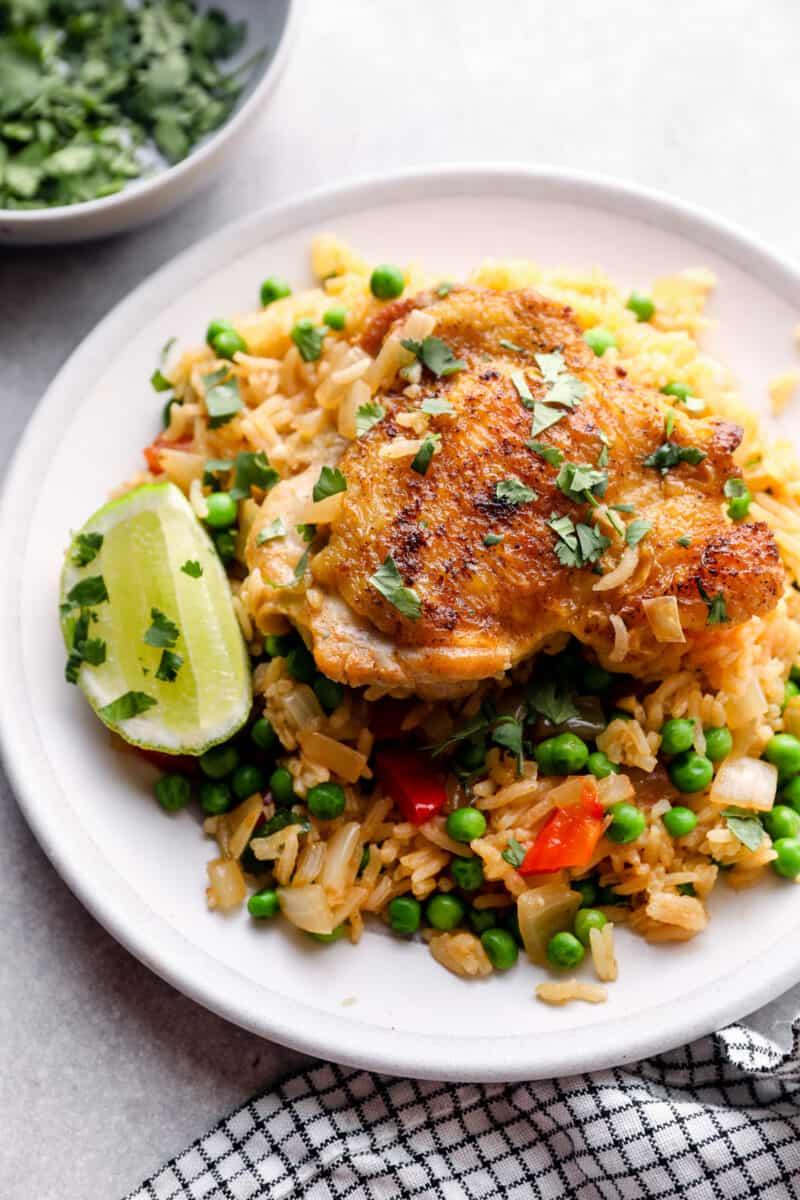 arroz con pollo chicken thigh on plate