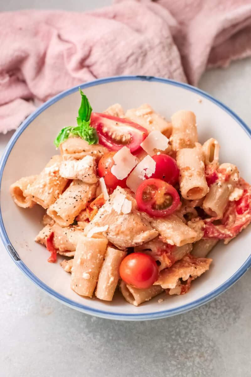 white bowl of baked chicken feta pasta