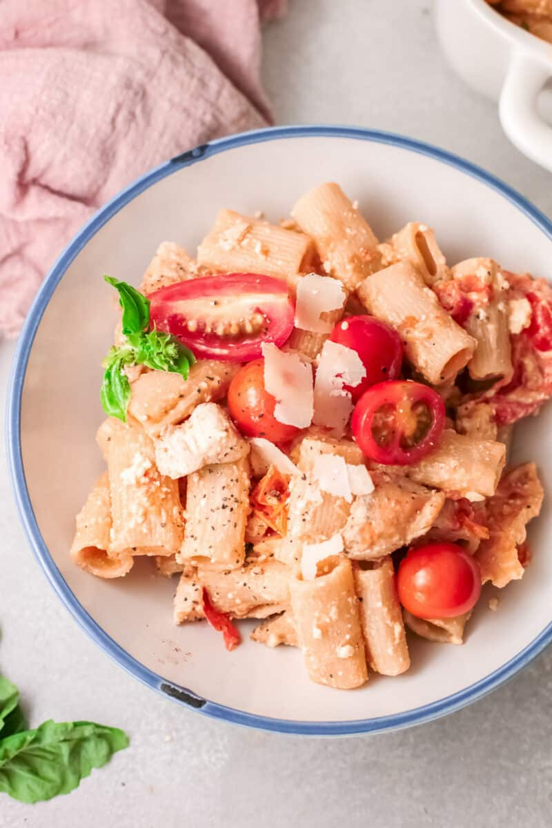 overhead white bowl of baked chicken feta pasta