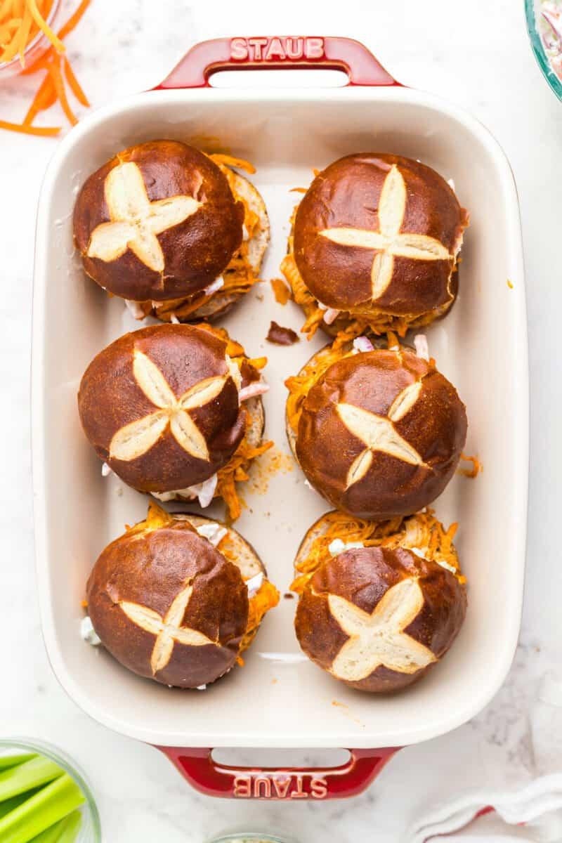 baked buffalo chicken sliders with pretzel buns