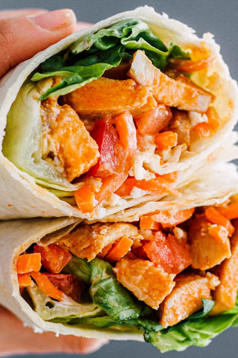 up close image of buffalo chicken wrap in hand