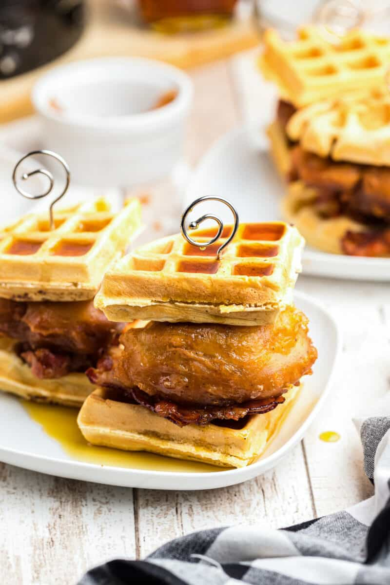 chicken and waffle sliders with bacon on plate