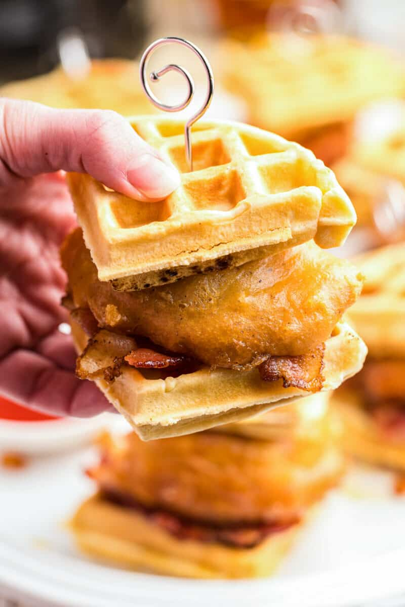 holding up chicken and waffle sliders