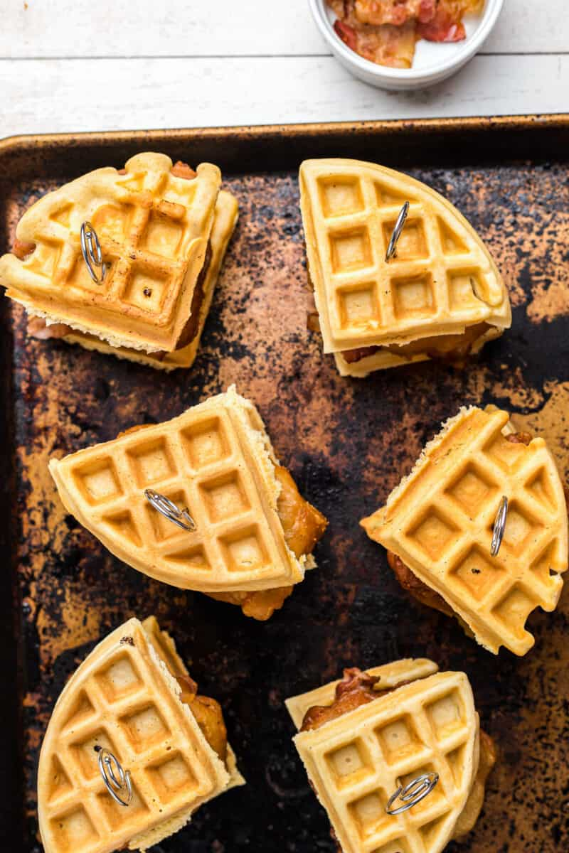 overhead chicken and waffle sliders on baking sheet