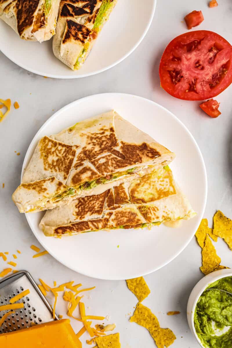 stacked chicken crunchwrap supremes on white plate