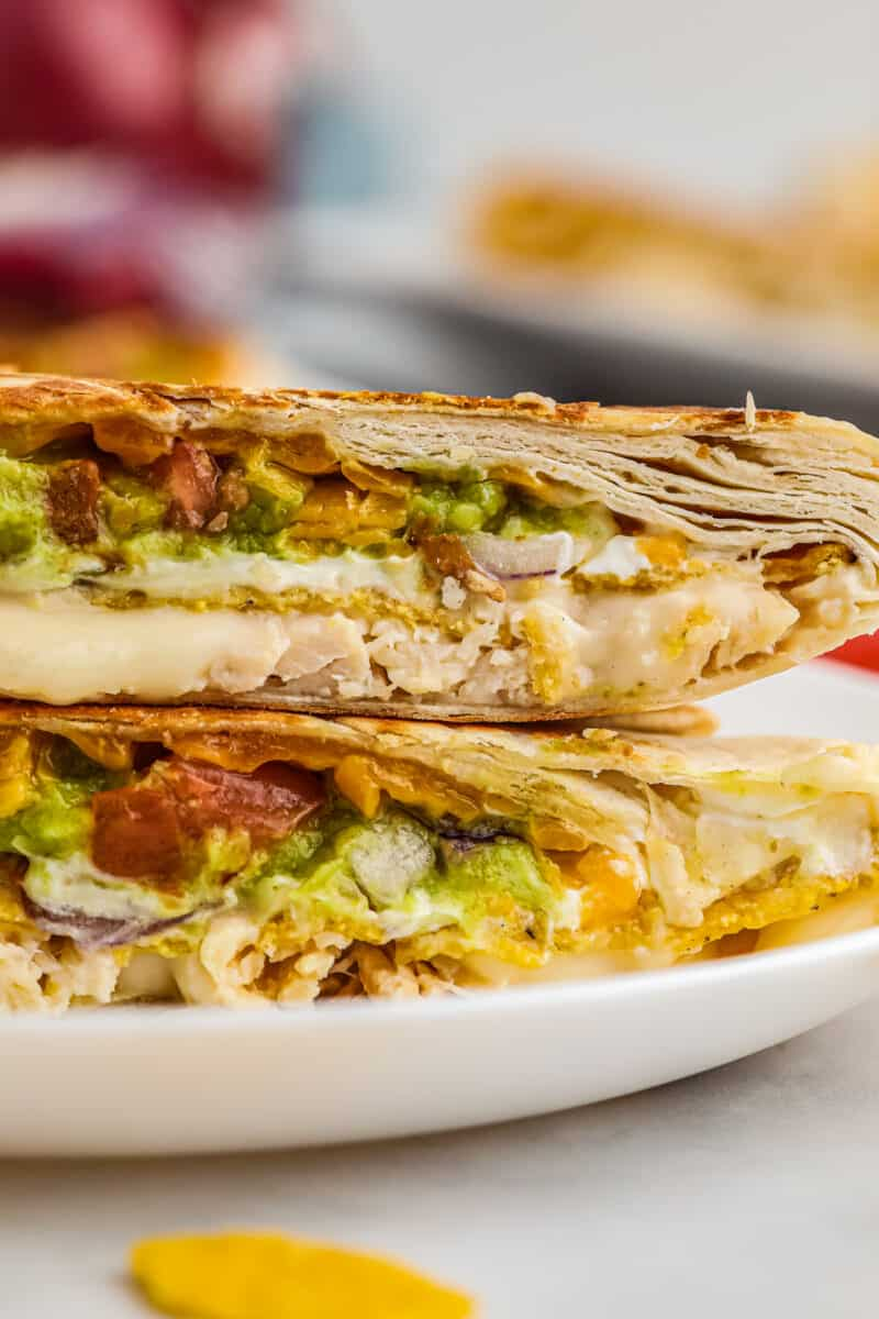 up close stacked chicken crunchwrap supremes on white plate