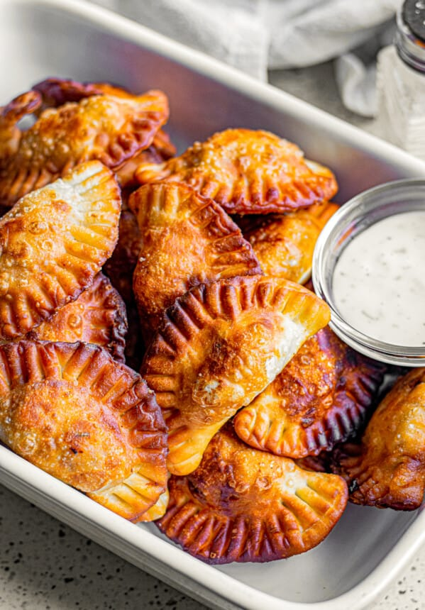 serving dish with chicken empanadas
