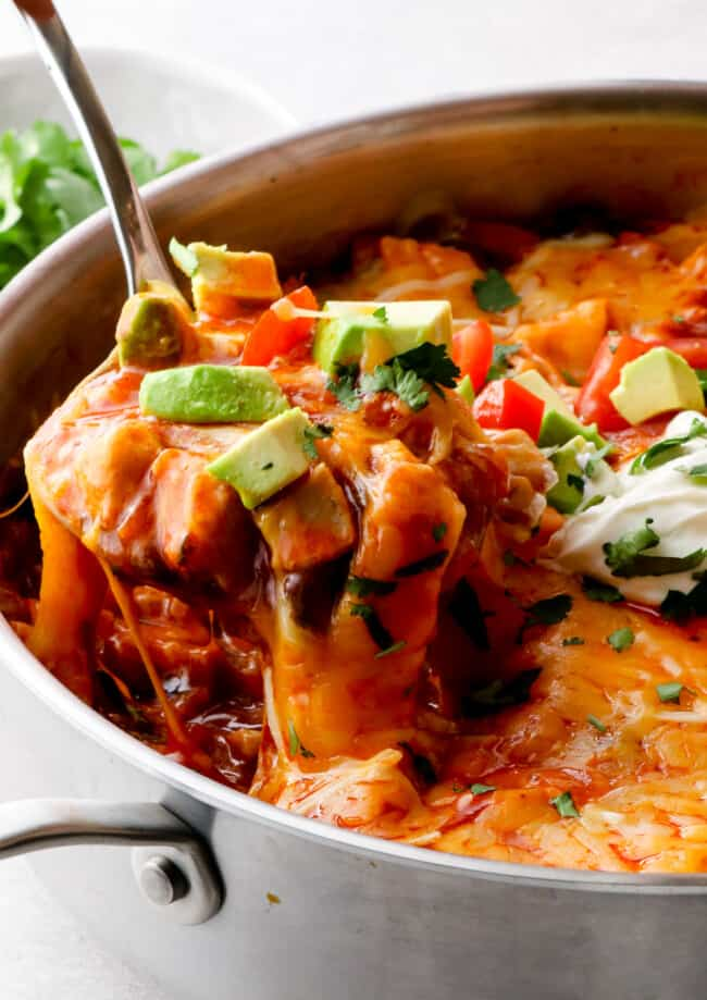 cheesy chicken enchilada skillet in pan