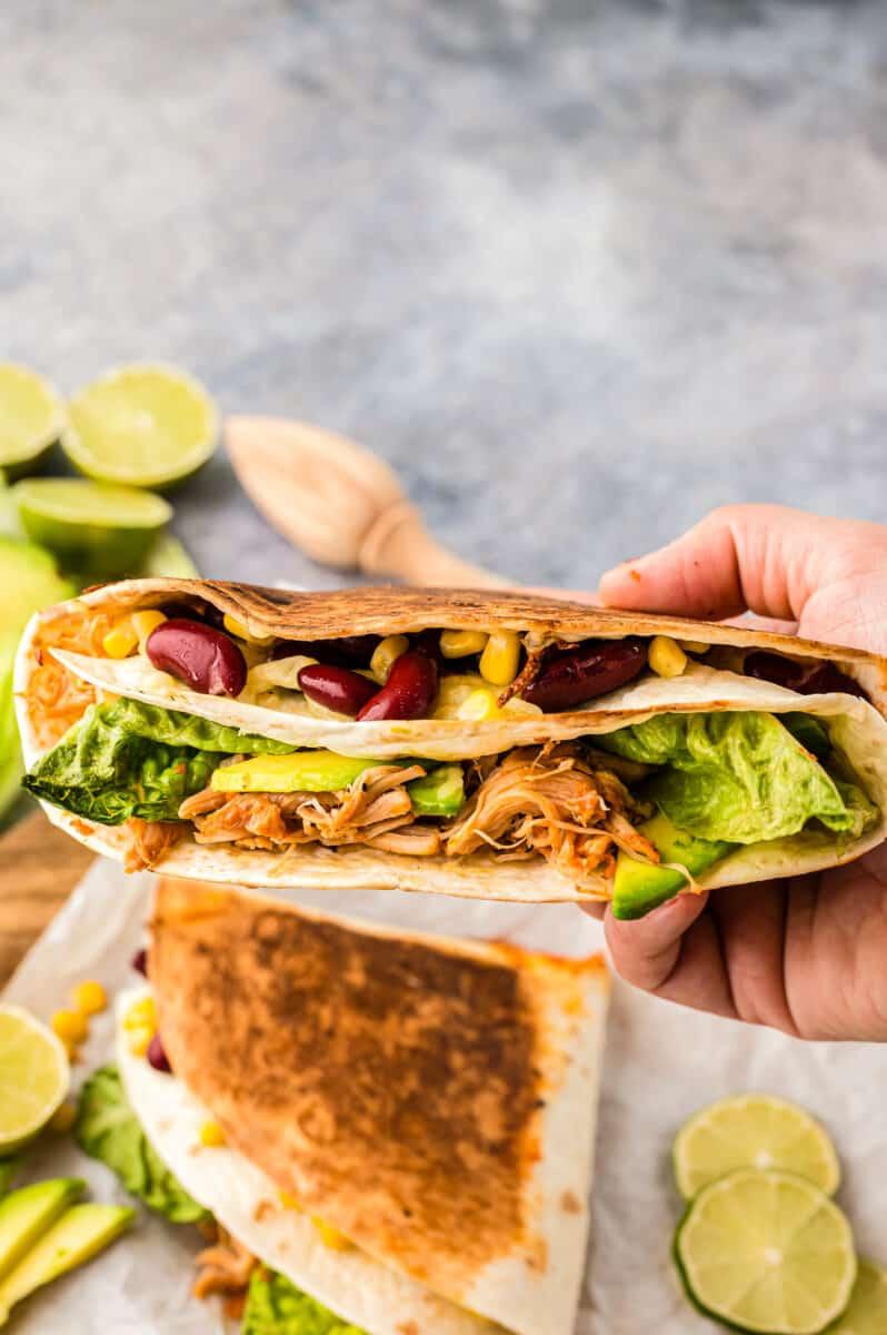 holding up foldover chicken quesadilla