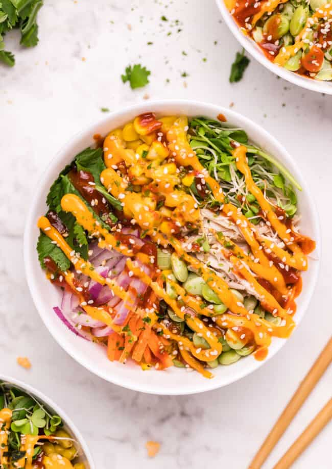 chicken poke bowl drizzled with sriracha mayo