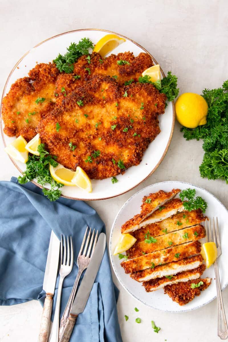 platter of chicken schnitzel next to plate
