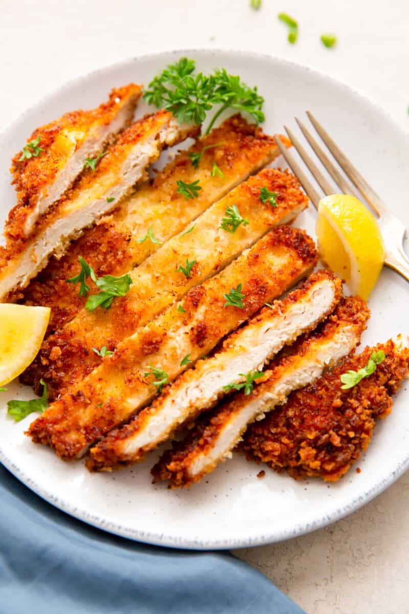 up close sliced chicken schnitzel on plate