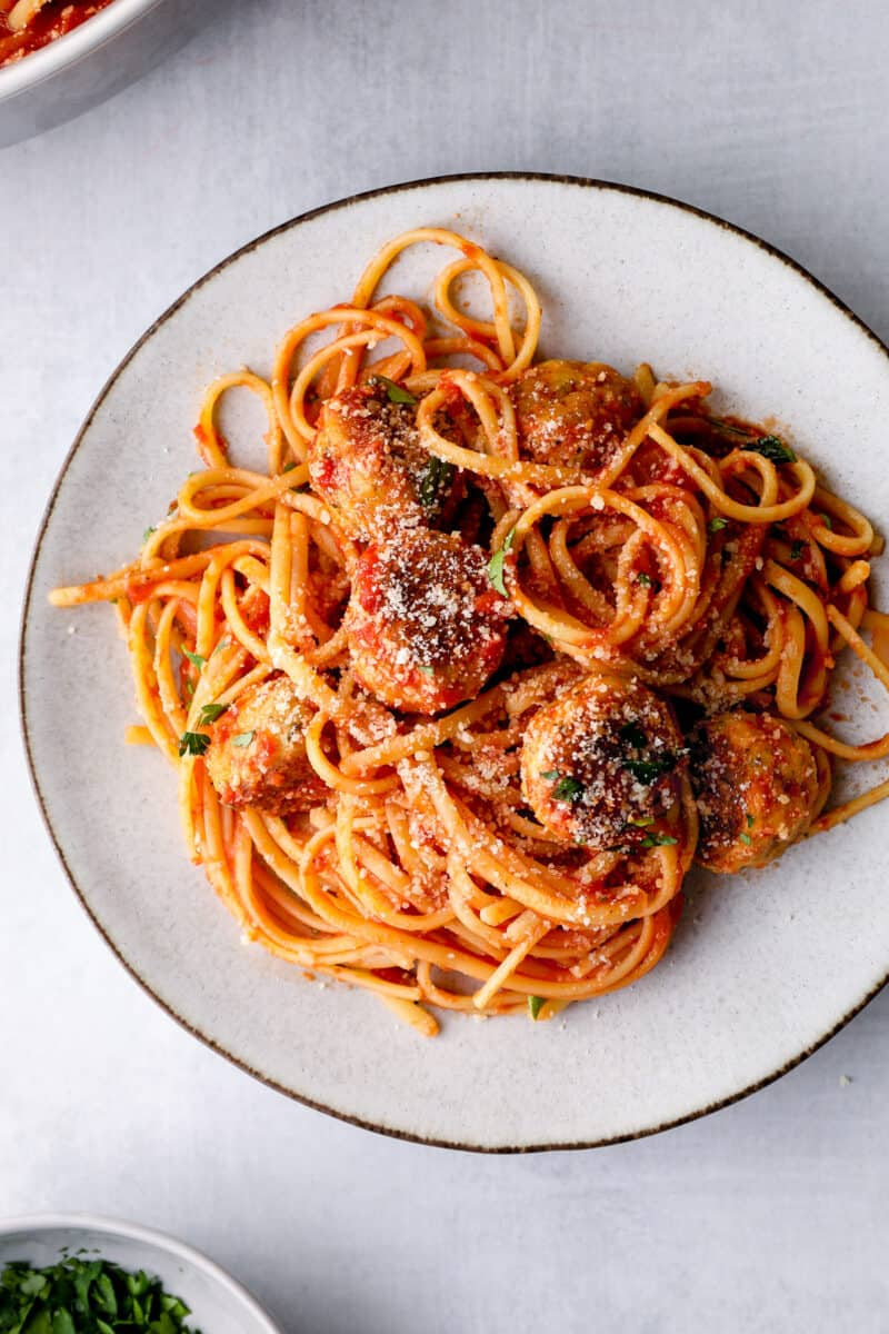 spaghetti with chicken meatballs on white plate