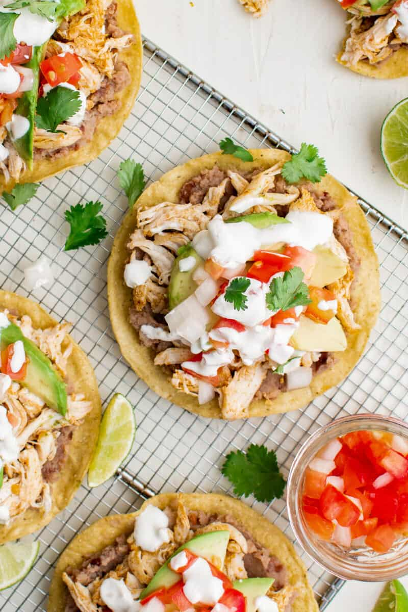 up close overhead image chicken tostadas on cooking rack