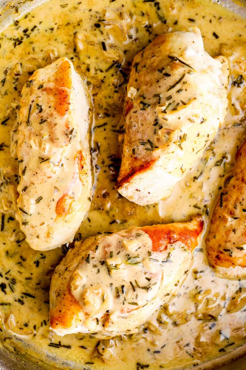 up close rosemary chicken with creamy sauce in skillet