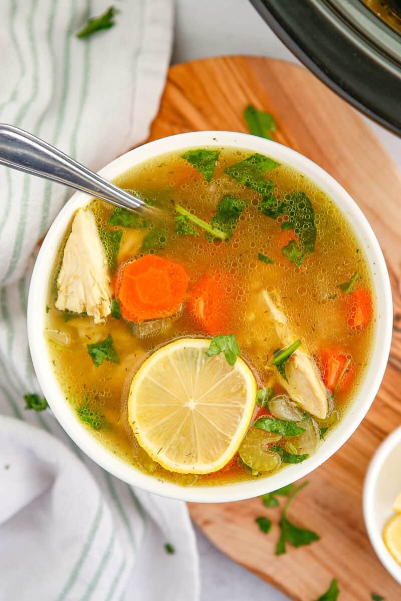 crockpot lemon chicken orzo soup in white bowl