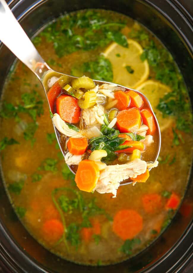 crockpot lemon chicken orzo soup in ladle