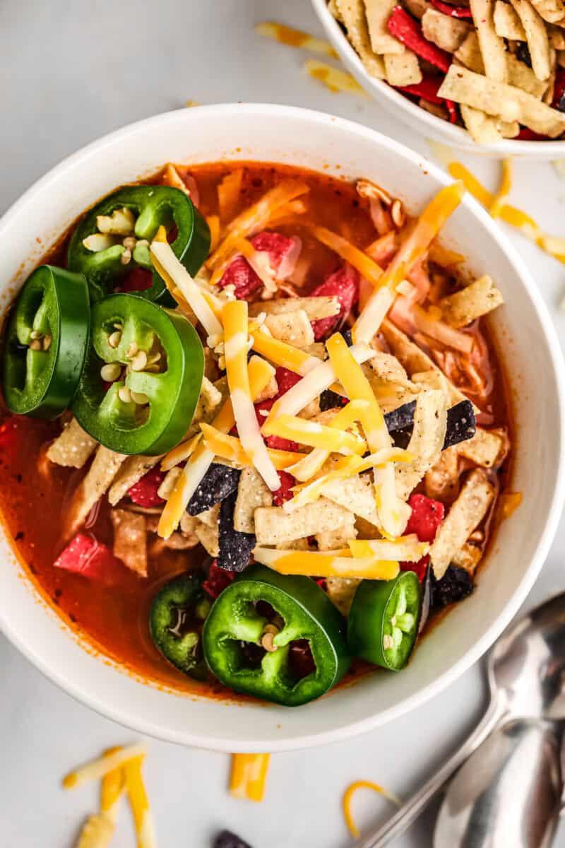 crockpot chicken tortilla soup in white bowl