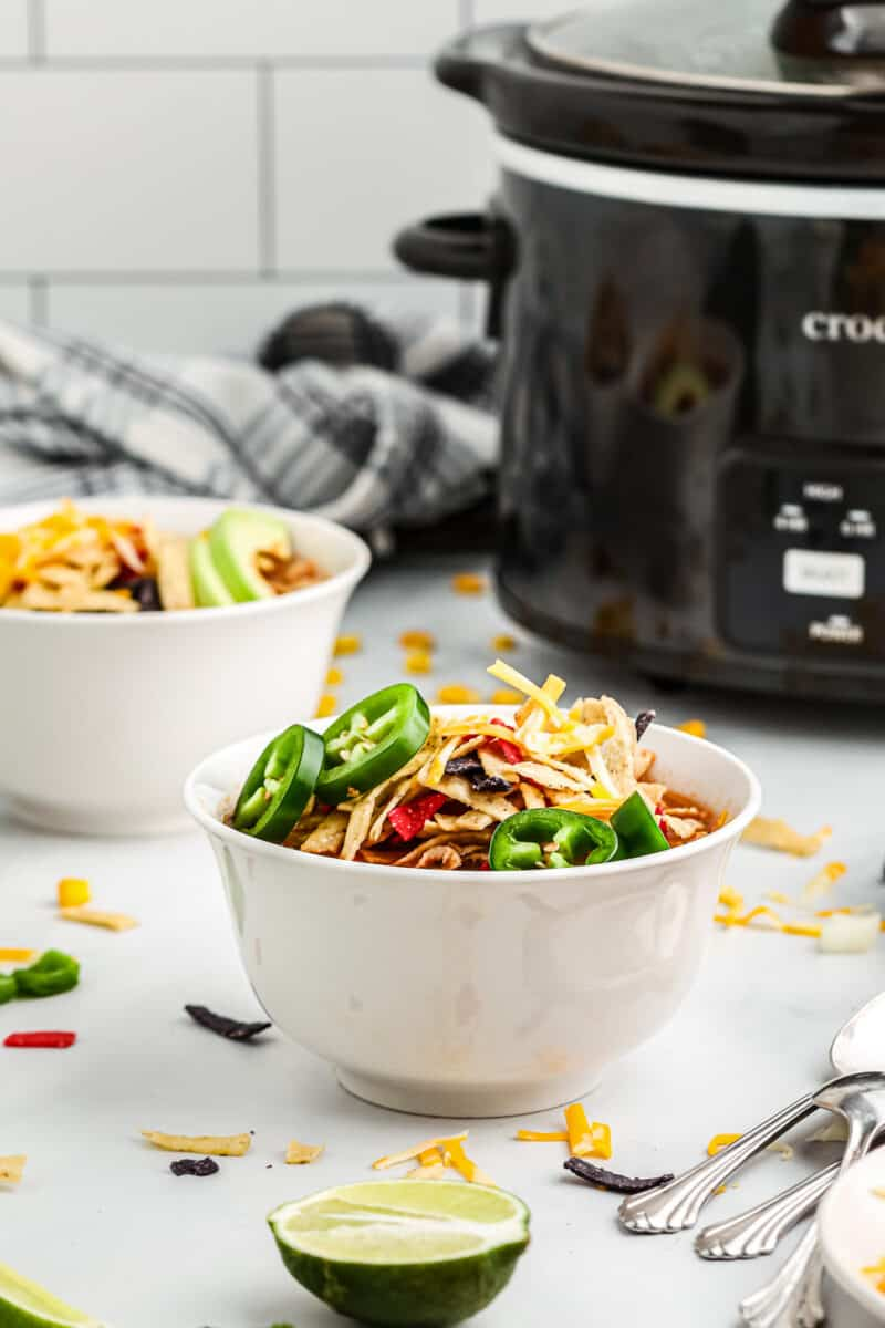 white bowls with crockpot chicken tortilla soup