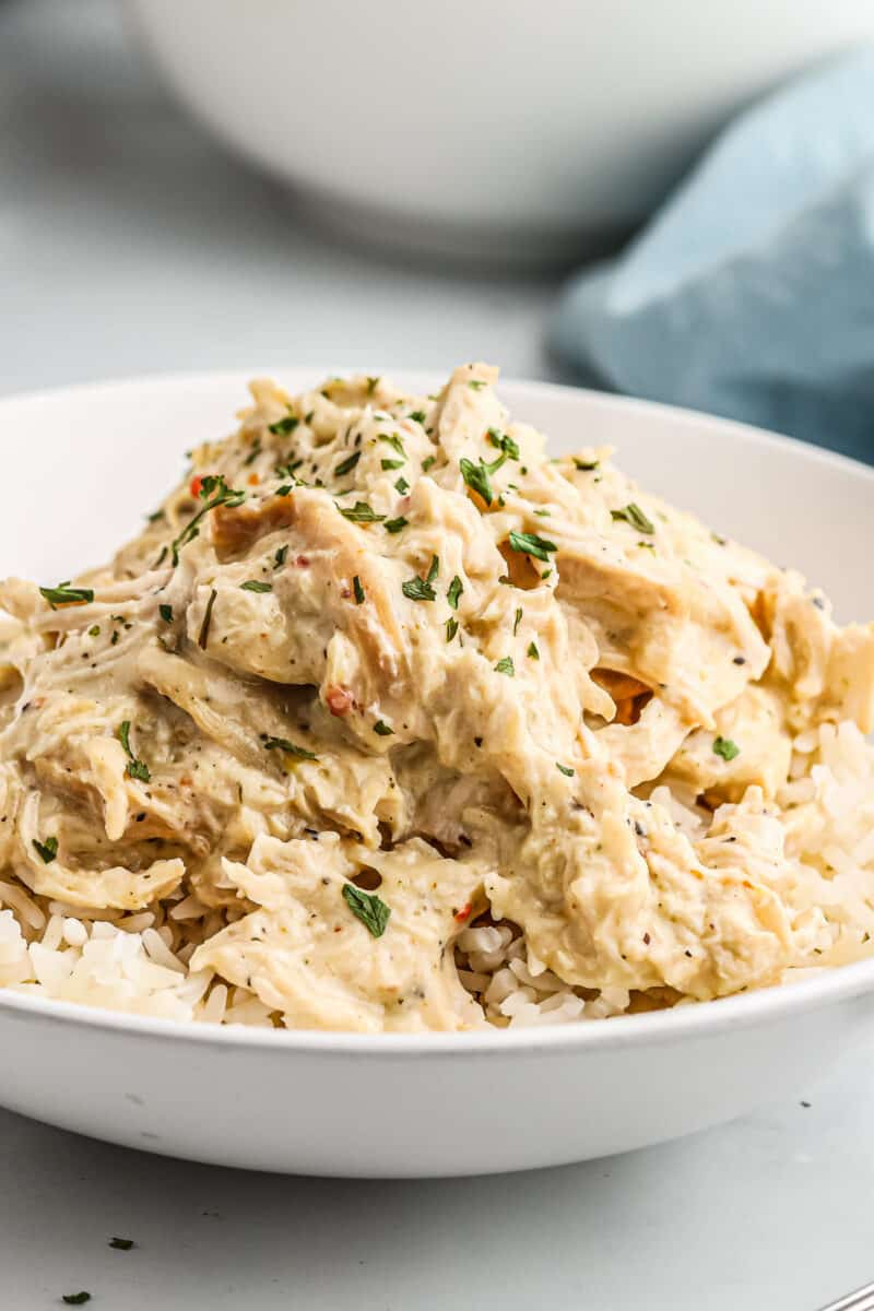 white bowl filled with rice and crockpot italian chicken