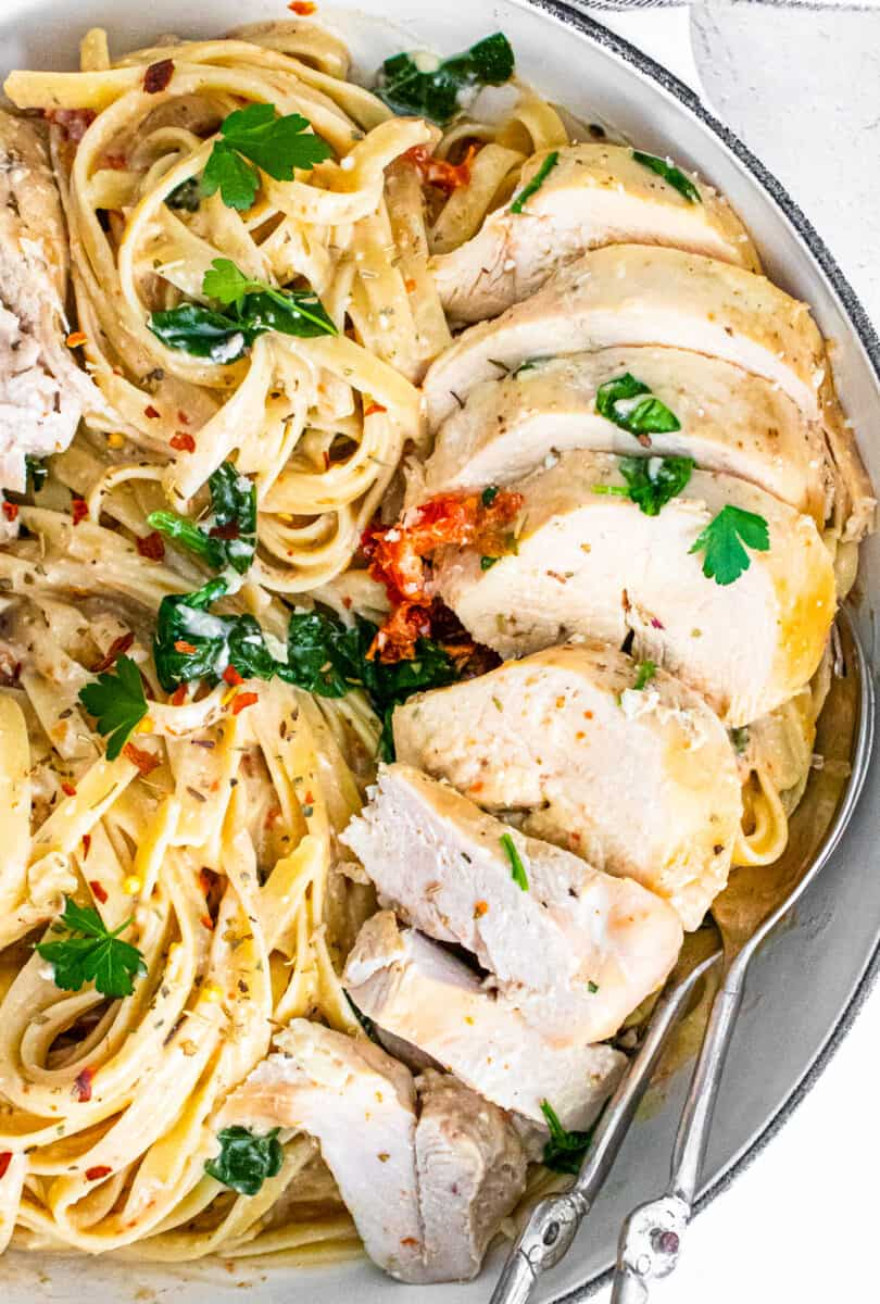 up close sliced crockpot tuscan chicken