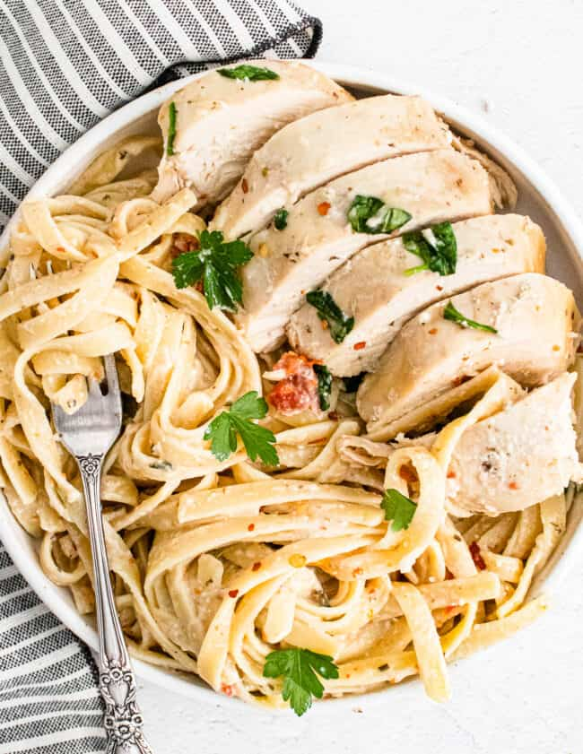 white plate with crockpot tuscan chicken