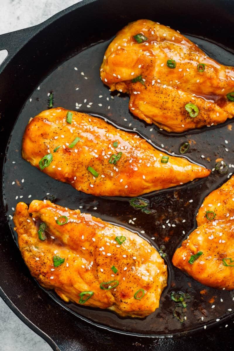 honey garlic chicken breasts in skillet