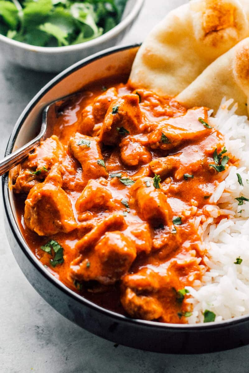 up close side shot of bowl of instant pot butter chicken