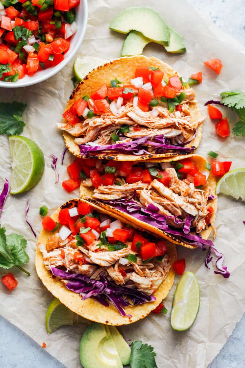 prepared instant pot chicken tacos in a row