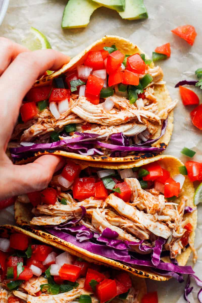 hand holding up instant pot chicken tacos