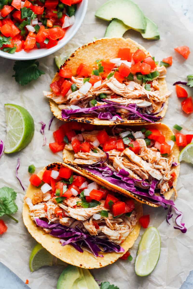 three prepared instant pot chicken tacos in a row