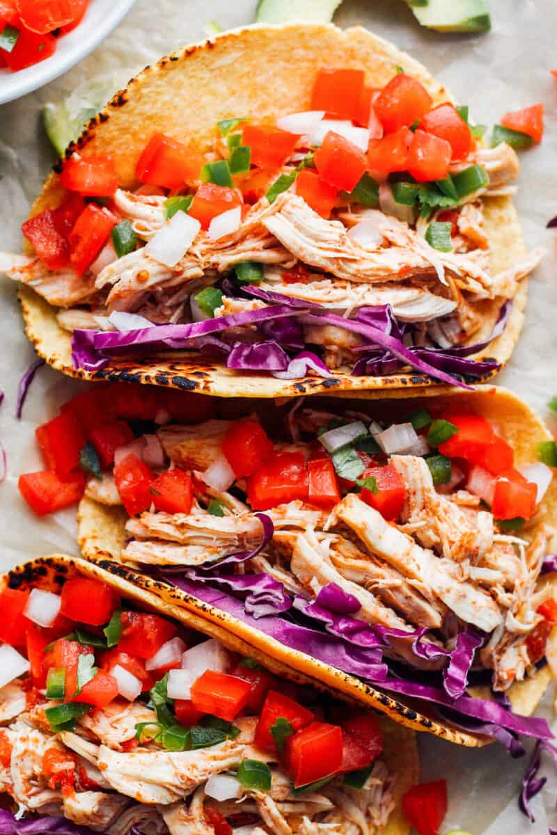 up close prepared instant pot chicken tacos in a row