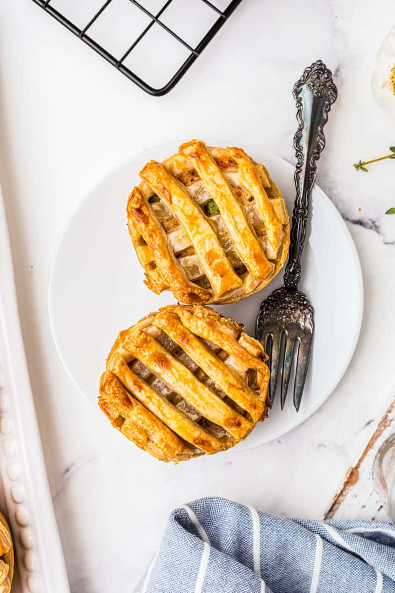 two mini chicken pot pies on white plate