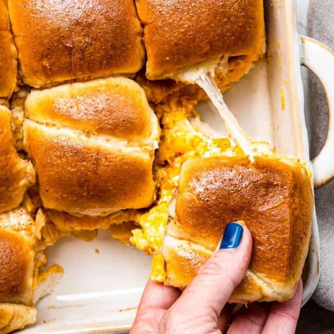 hand picking up pull apart breakfast sandwich