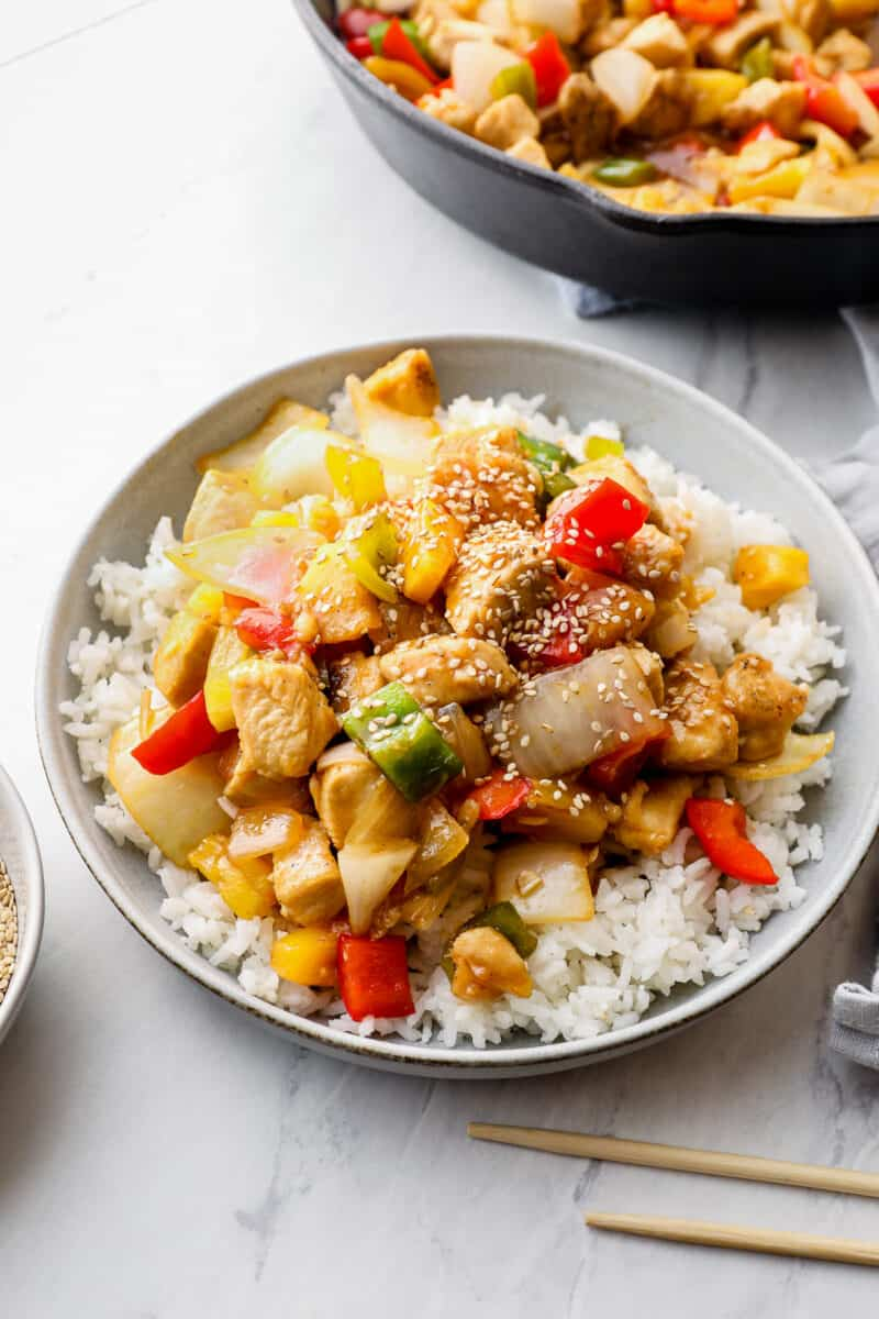 side sweet and sour chicken over white rice on gray plate
