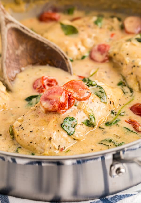 tuscan chicken with cream sauce in skillet