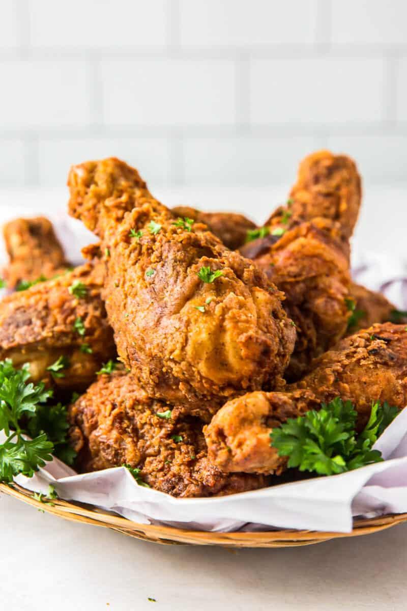 fried chicken drumsticks on platter