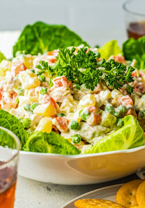 side shot of chicken potato salad over lettuce