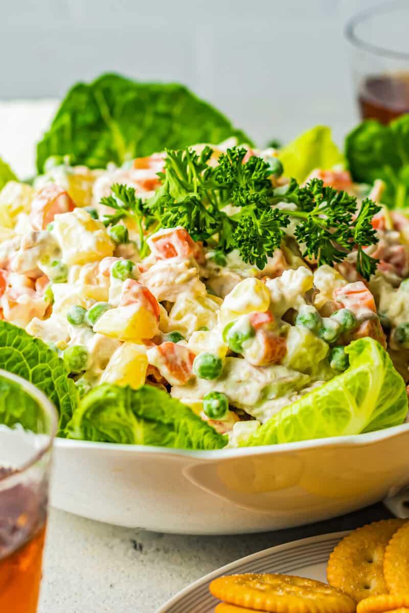side shot of chicken potato salad over lettuce