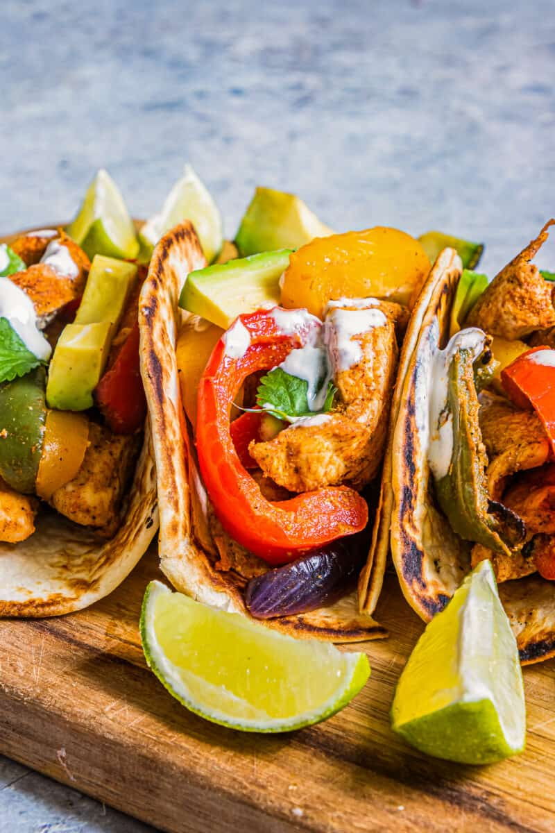 three chicken fajitas in tortillas