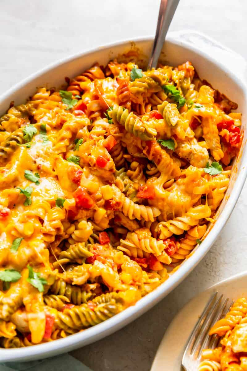 casserole dish with chicken enchilada pasta bake