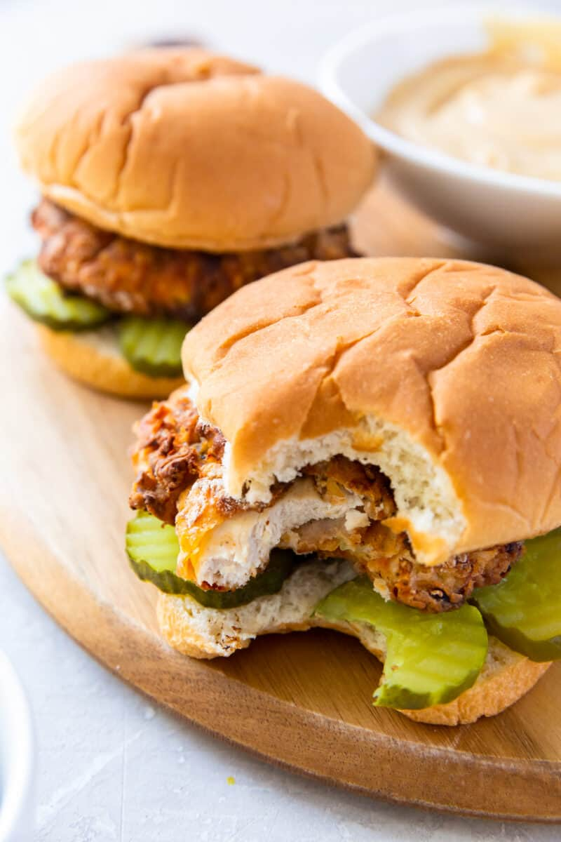 bite out of chick fil a sandwich with pickles