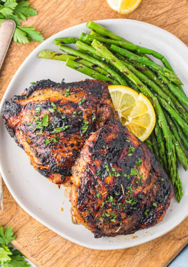 plate of grilled chicken thighs with asparagus