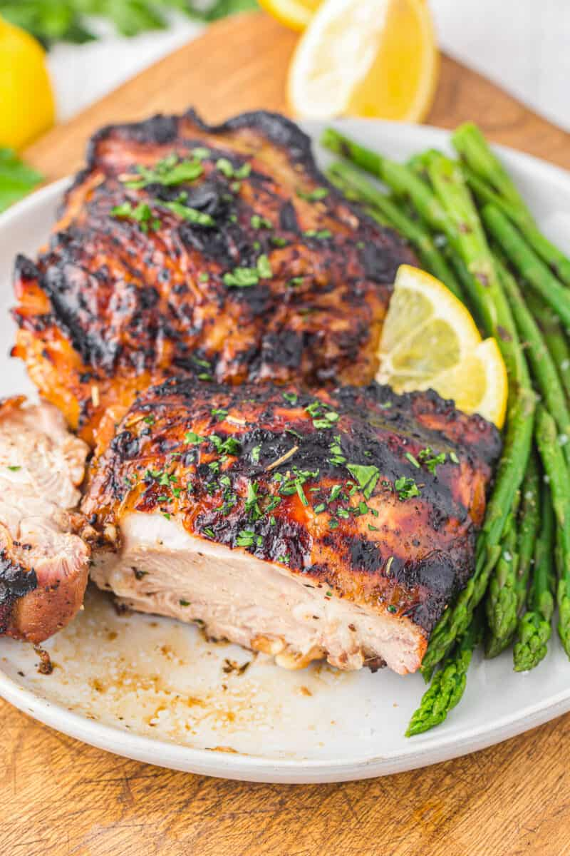 cut into grilled chicken thighs