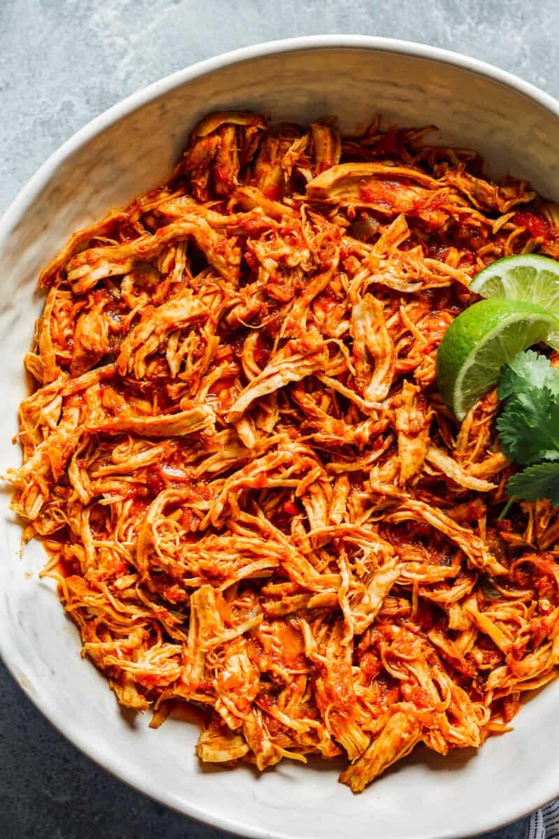 shredded instant pot salsa chicken in white bowl