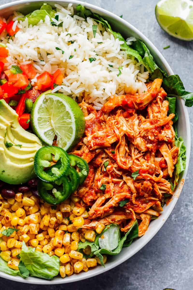 bowl of instant pot shredded chicken with rice and corn
