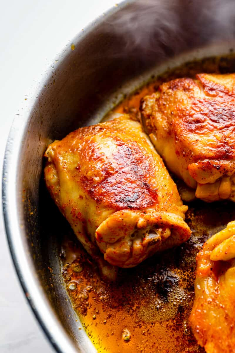 browned chicken thighs in sauce